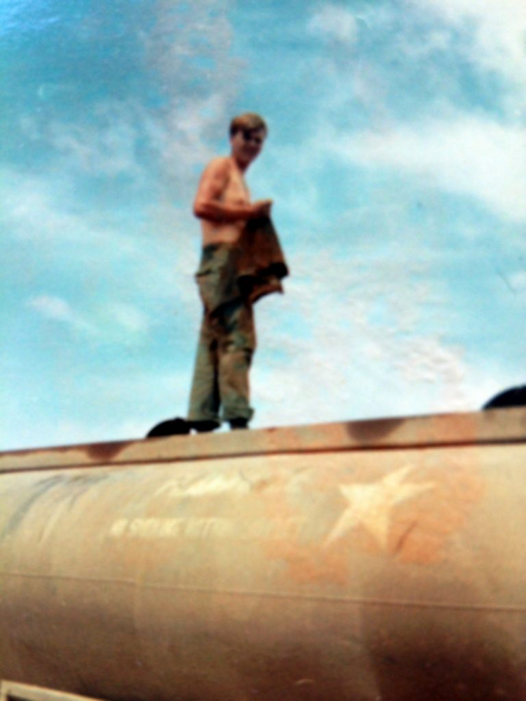 cj003_jimmy_ray_callison_standing_on_his_tanker_befor_he_drove_the_gun_truck_brutus