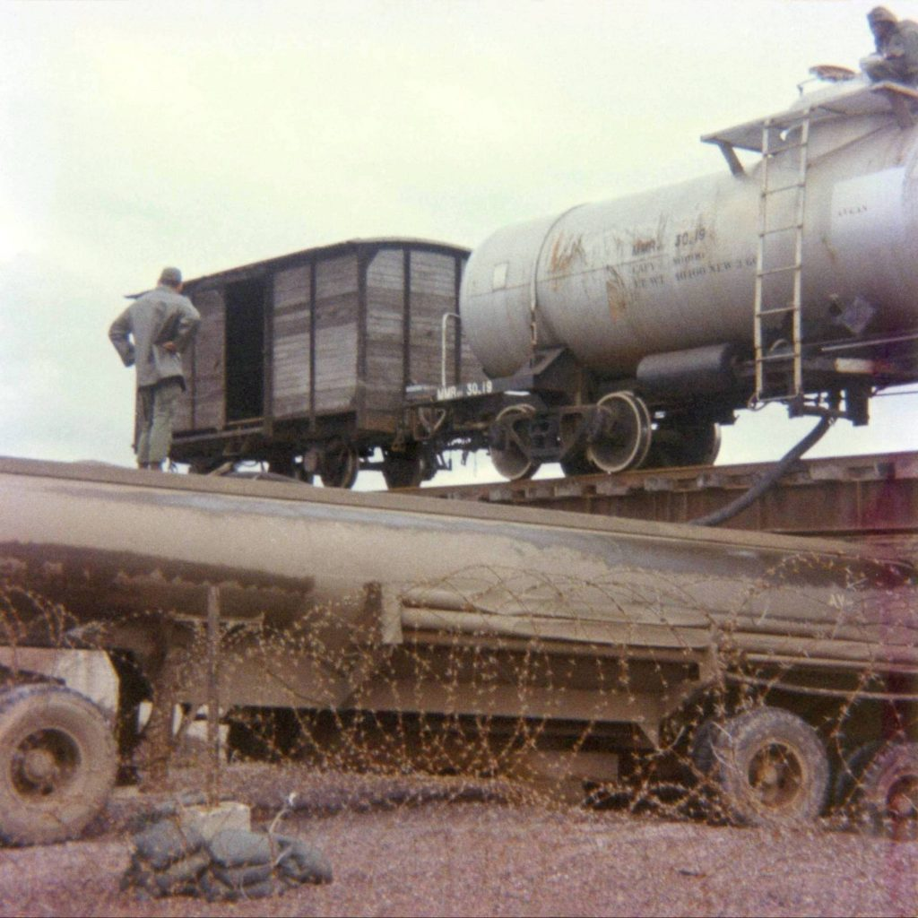 jl001-359-tc-tanker-being-filled-from-rail-car-1971