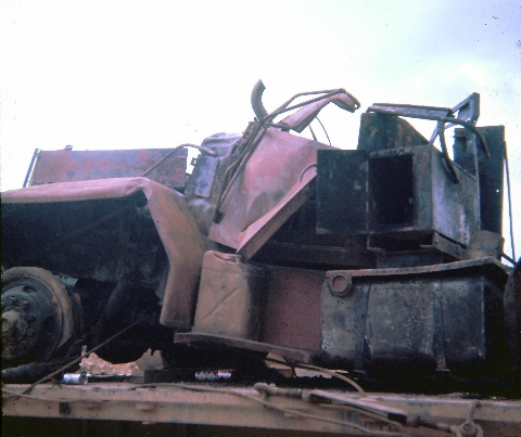 ko_002_burned_tractor_cab_from_motor_pool_fire_1_